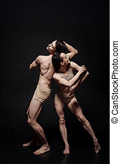 Inventive dance couple taking part in the art performance