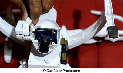 Inventive Old man modifying quad copter on-board camera -...