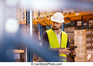Nice serious man looking at the boxes