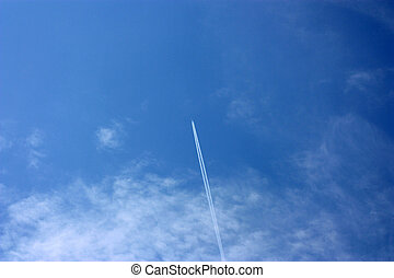 inverse track from airplane on the cloudy sky. White clouds...