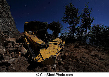 Inverted excavator on the road. Moonlit Night in the Himalayas