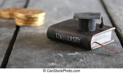 Invest in education concept, book and money - University...