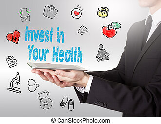 Invest in your health concept. Healty lifestyle background. Man holding a tablet computer