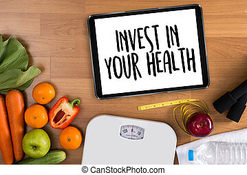 Invest in your health , Healthy lifestyle concept with diet and fitness , Get fit in 2017 , fitness equipment and healthy food