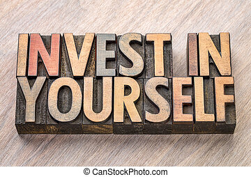 invest in yourself word abstract in wood type