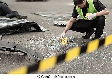 Investigation at road accident area - Policeman during...