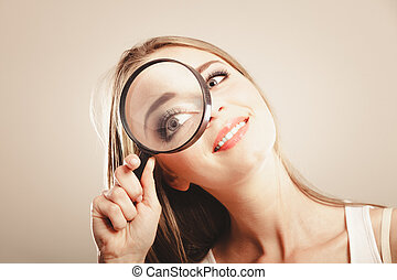 girl holding on eye magnifying glass loupe