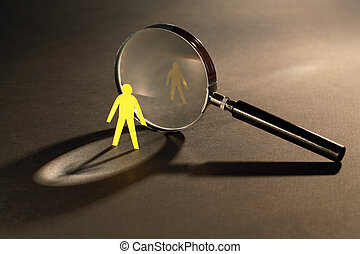 Investigation - Small yellow paper man standing opposire...