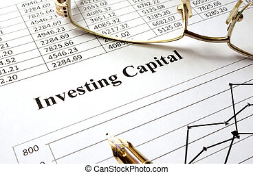 investing capital - Sign investing capital on a paper and...