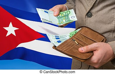 Investing money to Cuba. Rich man with a lot of money.