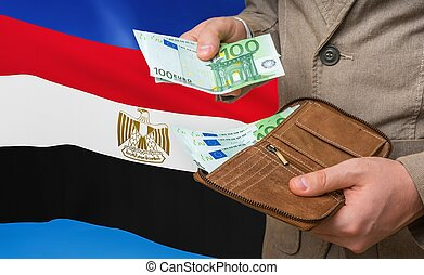 Investing money to Egypt. Rich man with a lot of money.