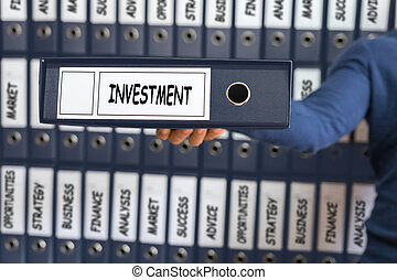 Investment Concept. Investment strategy. Young man holding ring binder.