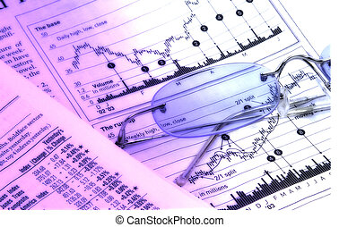 Investment Gains - Photo of Stock Charts and Eyeglasses With...