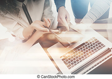 Investment managers work process.Photo man showing reports modern tablet screen.Statistics graphics screen.Private banker holding pen for signs documents.Business project startup.Film and bokeh effect