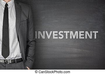 Investment on blackboard - Investment word on black...