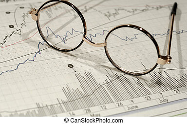 Investment Research - Photo of Eyeglasses on Top of Stock...