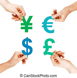 four hands holding currency symbols - investment, stock...