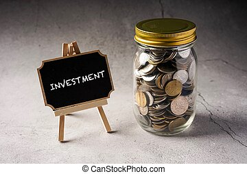 Investment wordings on chalkboard