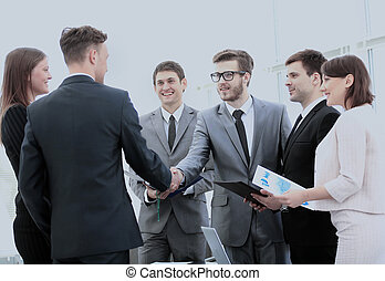 investor and CFO in the presence of a business team shake...