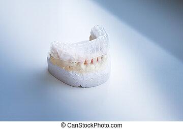Invisalign, invisible plastic teeth aligner on a dental...