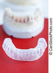 Invisalign, invisible plastic teeth aligner with dental...