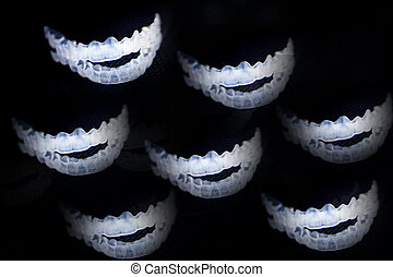 Invisible dental retention splint on black background
