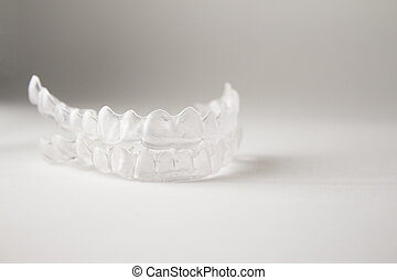 Invisible orthodontics - Postural plastic denture teeth...