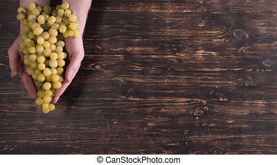 invisible person arms with grapes.