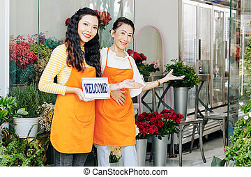 Inviting customers in flower shop