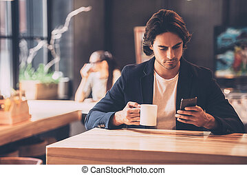 bdd9720bf77 Typing business message. side view of confident young man in smart ...