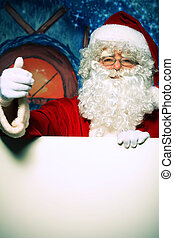 inviting - Santa Claus holding white board over Christmas...