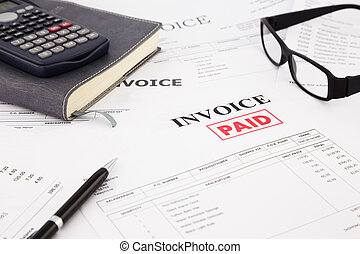 invoice and bills with paid stamp - close-up picture of...
