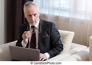 Involved businessman working with the laptop in the hotel