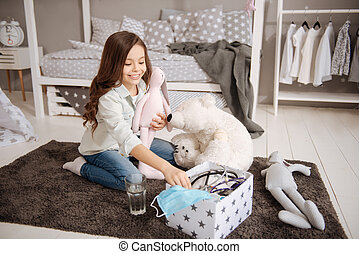 Involved girl playing with toys in the bedroom - Enjoying...