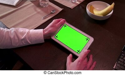 Ipad Tablet Green Screen Monitor - Man touching ipad green...