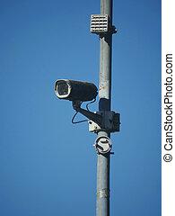 IR surveillance camera against blue sky