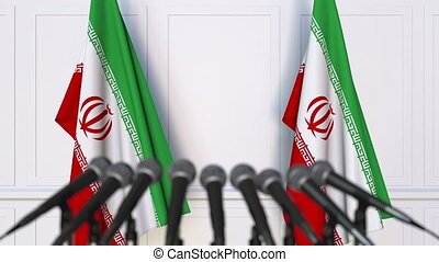 Iranian official press conference. Flags of Iran and...
