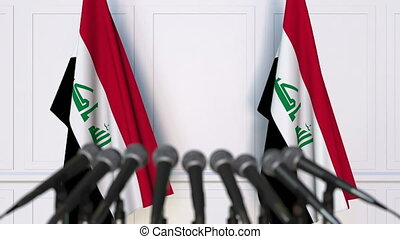 Iraqi official press conference with flags of Iraq. 3D...