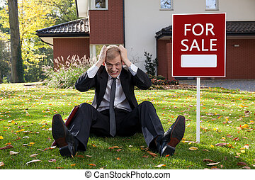 Irate man - Young irate man trying to sell the house
