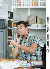Irate office worker on the phone
