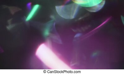 Iridescent festive garlands blinking in the dark. Abstract creative background.