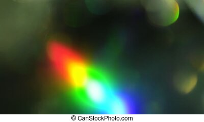 Iridescent foil. Beautiful colorful lights on dark...