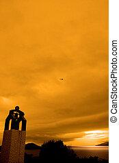 irish bell tower at sunset