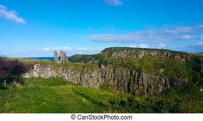 Irish Cliffside Ruins - Old ruins overlook a beautiful green...