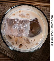 Irish Cream Liqueur (detailed close-up shot) on wooden ...