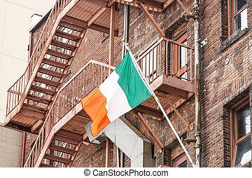 Irish Flag on Old Red Brick Buildings