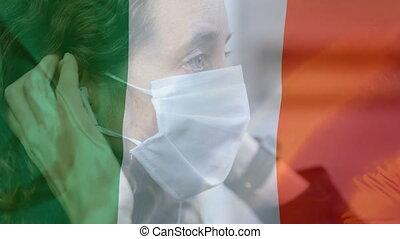 Animation of Irish flag waving overCaucasian woman wearing a face mask . Covid-19 coronavirus national health safety concept digital composite