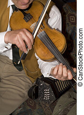 Irish Folk Fidddle Player - A close up portrait of an Irish...