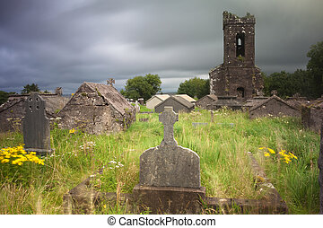 Irish graveyard cemetary dark clouds - Irish graveyard at...