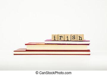 irish language word on wood stamps and books